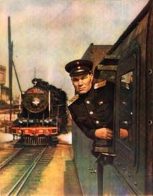 Машинист паровоза «ИС» инженер-лейтенант тяги (средний начсостав) в повседневной форме образца 1943 года (фото 1950 года)